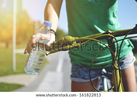 young woman with bicycle  outdoors - stock photo