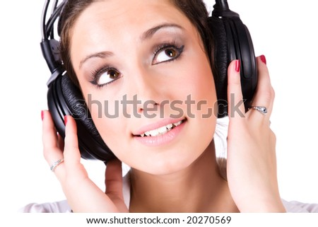 Young woman with big headphones. Isolated on white. - stock photo