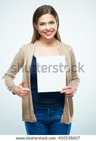 Young woman with big toothy smile hold white blank sign board and show thumb up.  - stock photo