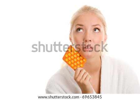 Young woman with blister of pills - stock photo