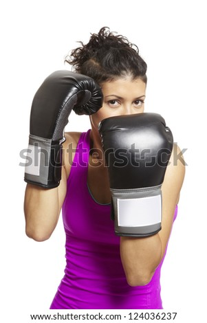 Young woman with boxing gloves sparring in sports outfit - stock photo