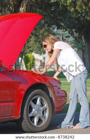 Young Woman with Broken Down Car - stock photo