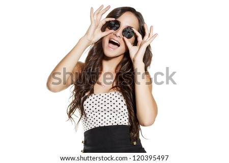 young woman with candy on eyes, funny expression. on white background - stock photo