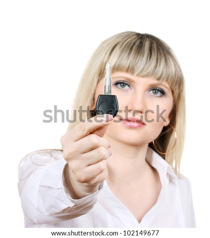Young woman with car keys isolated on white - stock photo