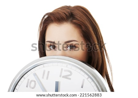 Young woman with clock. Time concept. - stock photo