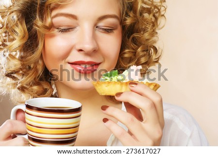 young woman with coffee and cookies. Studio shot. - stock photo