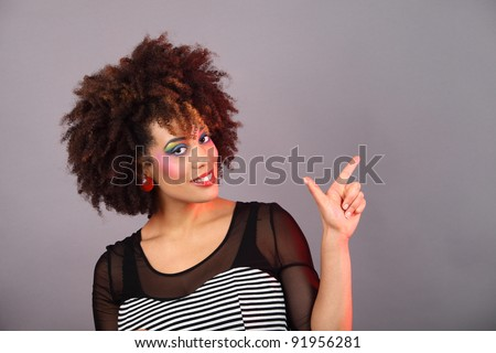 young woman with colorful make up  gesturing  color gels used - stock photo