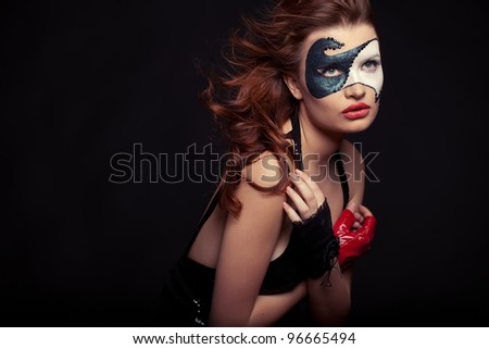 Young woman with creative make-up - stock photo