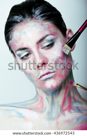 young woman with creative make up like painted oil picture on face - stock photo