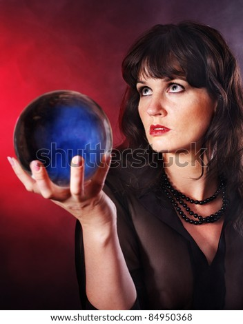 Young woman  with crystal ball. Fortune telling. - stock photo