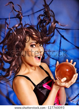 Young woman  with crystal ball. Halloween. - stock photo
