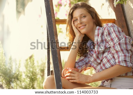 Young woman with cup of coffee enjoy the sunset - stock photo