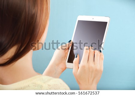 young woman with digital tablet - stock photo