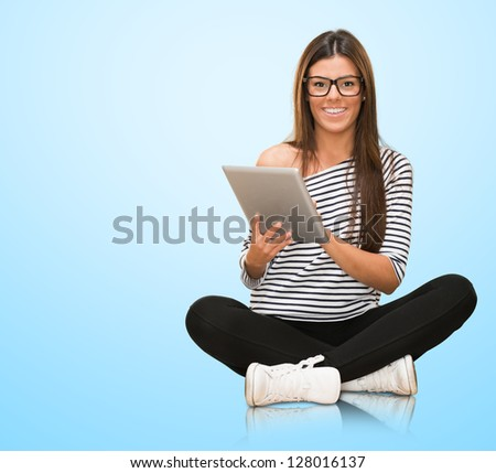 Young Woman With Digital Tablet Isolated On Blue Background - stock photo