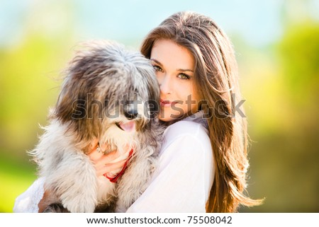young woman with dog outdoor day portrait - stock photo