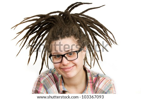 Young woman with dreadlocks wearing glasses and a shirt - stock photo
