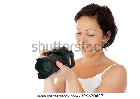 Young woman with DSLR isolated - stock photo