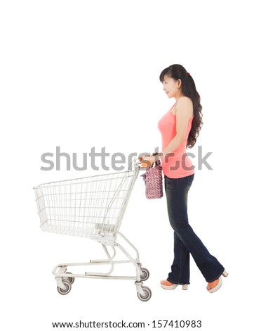 young woman with empty shopping cart - stock photo