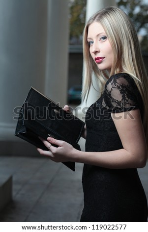Young woman with empty wallet. - stock photo