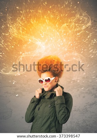 Young woman with energetic exploding red hair concept on background - stock photo