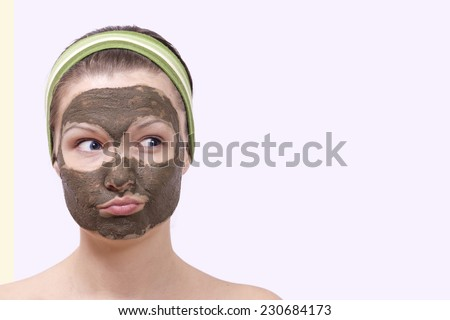 Young woman with face mask on her face - stock photo