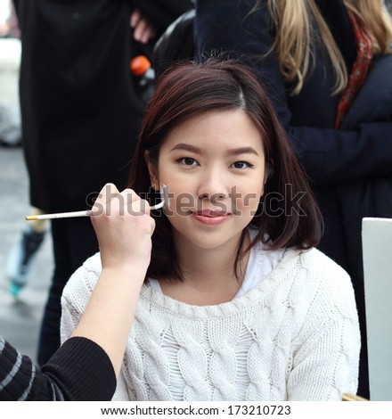 Young woman with face painting - stock photo