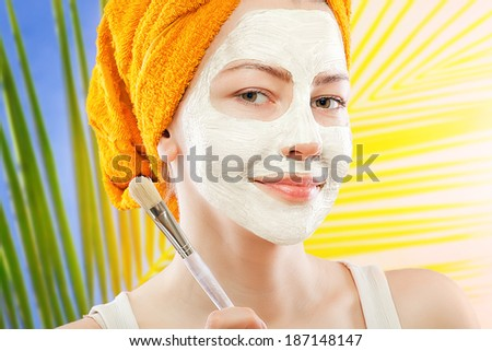 young woman with facial mask - stock photo
