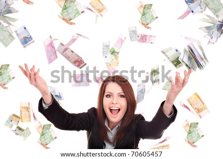 Young woman with flying money. Isolated. - stock photo
