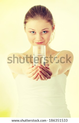 Young woman with fresh cold water in glass - stock photo