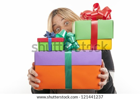 young woman with gifts. Shot in studio. isolated on white - stock photo