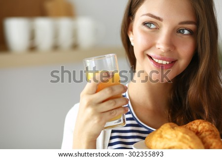 Young woman with glass of juice and cakes . - stock photo