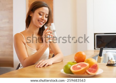 Young Woman with glass of Water. Healthy Lifestyle - stock photo