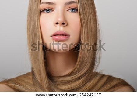 Young woman with gorgeous beautiful long straight hair. Blond Hair. - stock photo