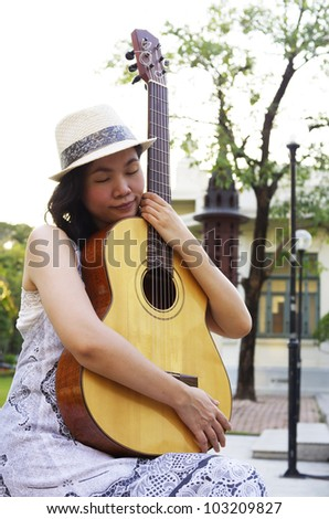 young woman with guitar - stock photo