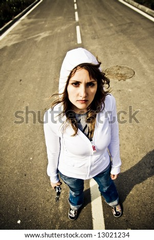 Young woman with gun, grunge style. - stock photo
