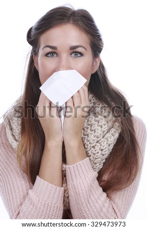 Young woman with handkerchief  blowing her nose - stock photo