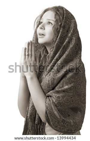 young woman with hands in praying, isolated on white - stock photo
