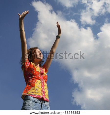 Young woman with hands up - stock photo
