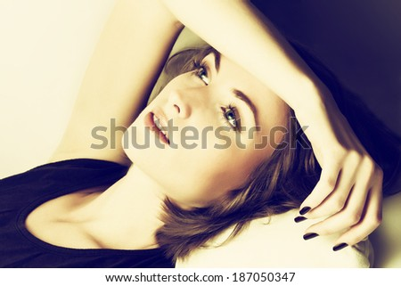 Young woman with headache concept. Toned image - stock photo