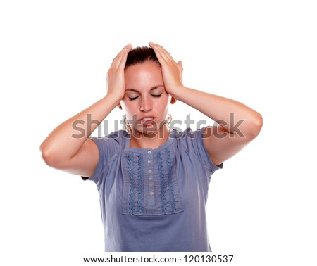 Young woman with headache holding her forehead over white background - stock photo