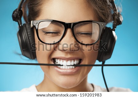 Young woman with headphones listening music . - stock photo
