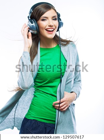 Young woman with headphones listening music .Music teenager girl dancing against isolated white background - stock photo