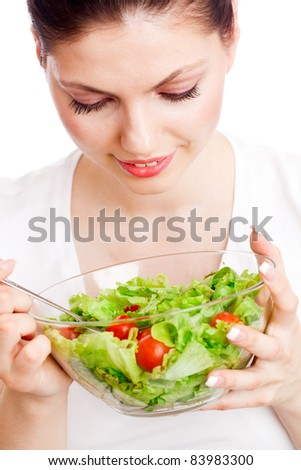 Young woman with healthy salad. Isolated over white. - stock photo