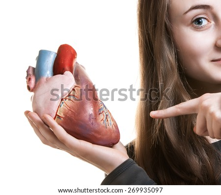 Young woman with heart in hand. Abstract creative background - stock photo