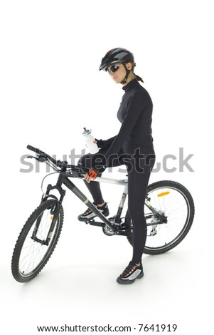 Young woman with helmet and sunglasses, sitting on mountain bike. White background. Whole body, side view - stock photo