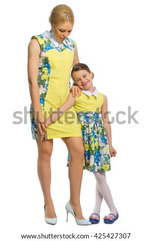 Young woman with her daughter in yellow dresses isolated - stock photo