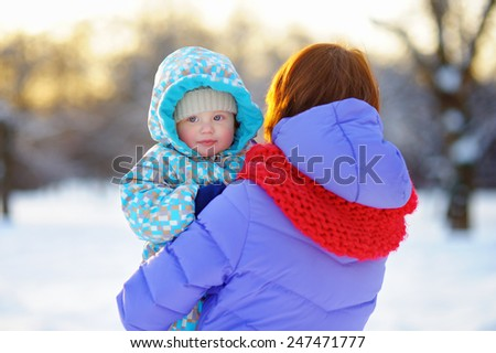 Young woman with her little baby boy  - stock photo