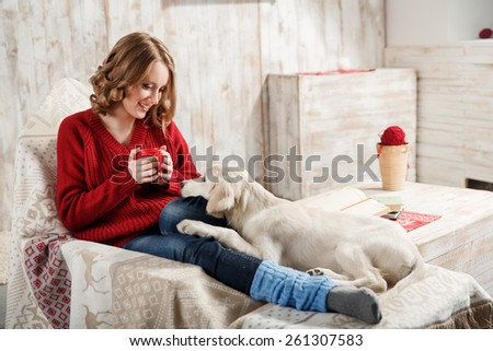 Young woman with her pet, golden retriever, relaxing together - stock photo