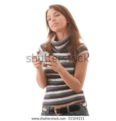 Young woman with hose model in hands isolated on white background - Real Estate loans concept - stock photo