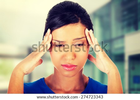 Young woman with huge head ache - stock photo